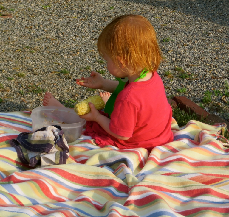 Enjoying a picnic in the gardens with our little friend