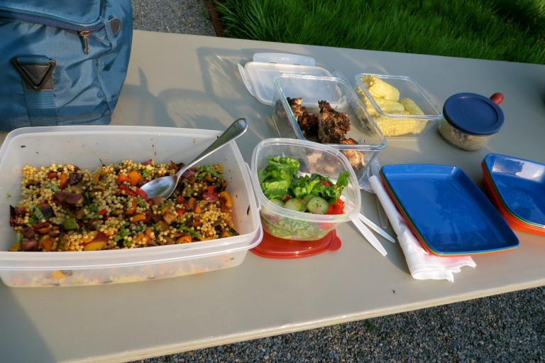 On the menu for the picnic, jerk chicken, corn on the cob, couscous with roasted vegetables, garden salad and strawberries with black bean brownies
