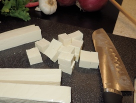 Cutting the paneer in cubes